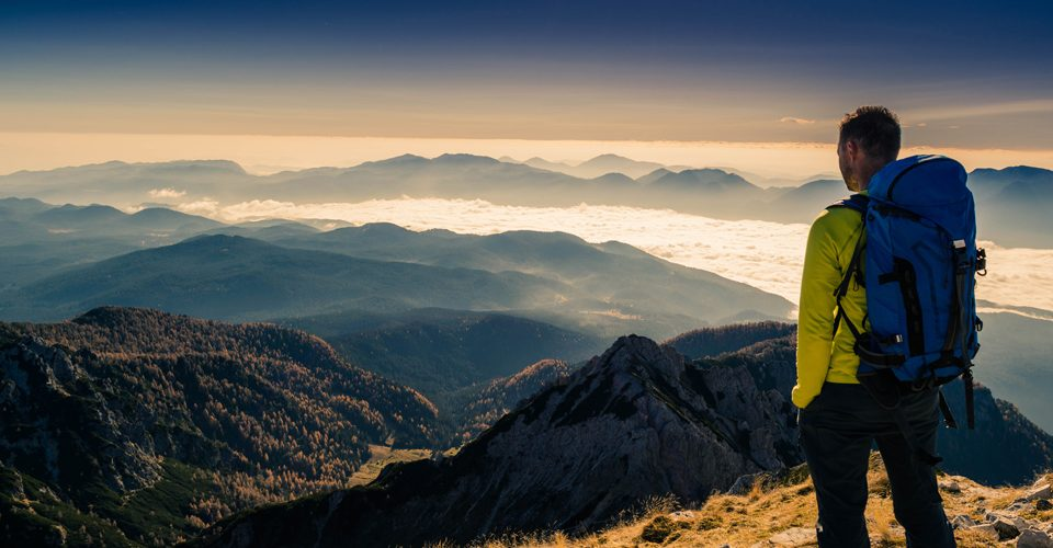 Man standing on top of a mountain